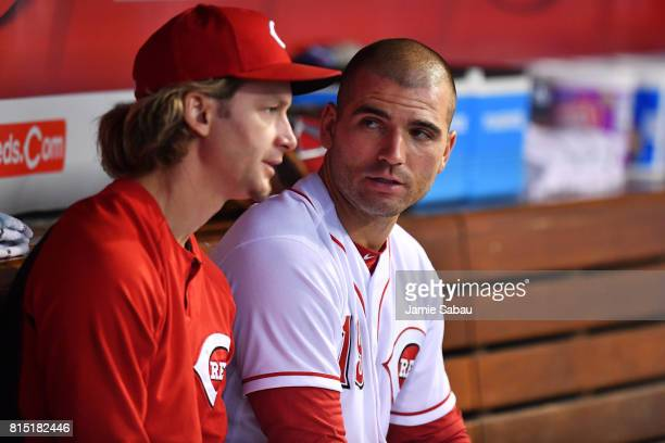 Joey Votto of the Cincinnati Reds talks with pitcher Bronson Arroyo of the Cincinnati Reds in the dugout during the sixth inning against the...