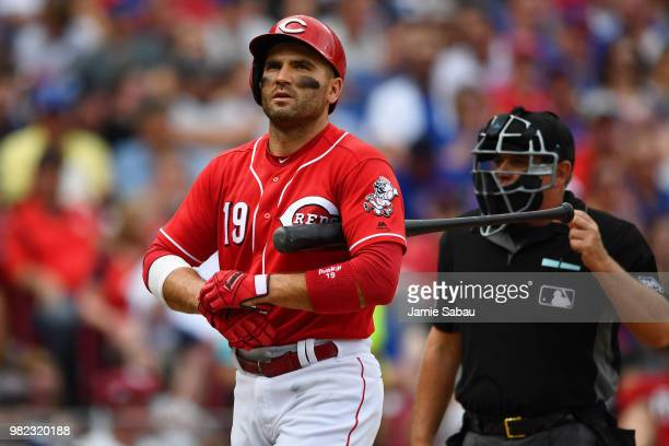 Joey Votto of the Cincinnati Reds walks back to the dugout after striking out to end the fourth inning against the Chicago Cubs at Great American...