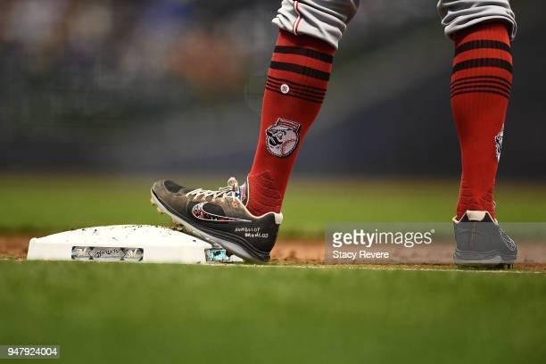 Joey Votto of the Cincinnati Reds wears Humboldt Broncos on his cleats during a game against the Milwaukee Brewers at Miller Park on April 17 2018 in...