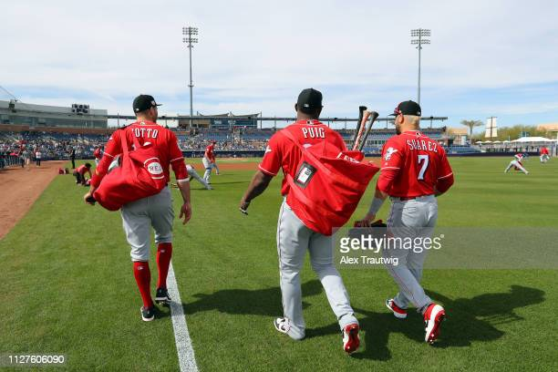 Joey Votto Yasiel Puig and Eugenio Suarez of the Cincinnati Reds walk to the dugout ahead of a Spring Training game against and the Seattle Mariners...