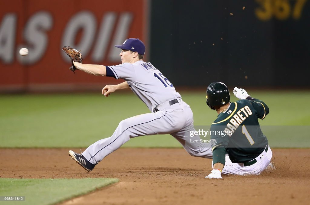Joey Wendle #18 of the Tampa Bay Rays catches the ball to force Franklin Barreto #1 of the Oakland Athletics out at second base in the fifth inning at Oakland Alameda Coliseum on May 29, 2018 in Oakland, California.