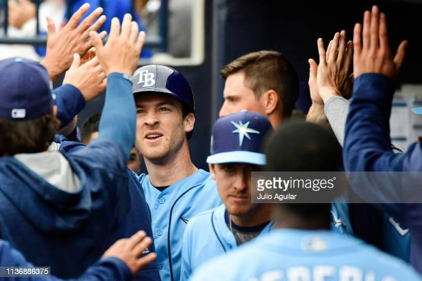 Joey Wendle of the Tampa Bay Rays celebrates with teammates after scoring on an error by Aaron Judge of the New York Yankees during the first inning...