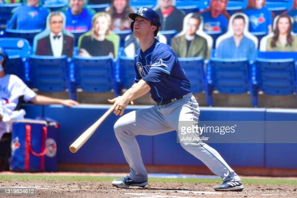 Joey Wendle of the Tampa Bay Rays hits a grand slam off of Trent Thornton of the Toronto Blue Jays in the first inning at Tropicana Field on May 24,...