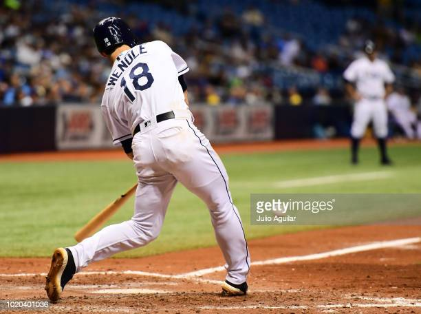 Joey Wendle of the Tampa Bay Rays hits a single in the eighth inning against the Kansas City Royals on August 20 2018 at Tropicana Field in St...