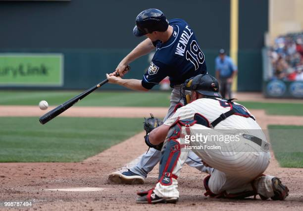 Joey Wendle of the Tampa Bay Rays hits a tworun triple as Bobby Wilson of the Minnesota Twins catches during the seventh inning of the game on July...