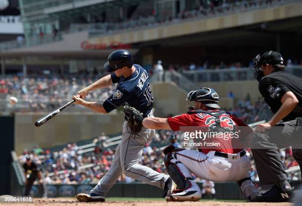 Joey Wendle of the Tampa Bay Rays hits an RBI single as Mitch Garver of the Minnesota Twins catches during the fifth inning of the game on July 15...