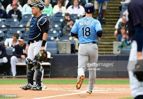 Joey Wendle of the Tampa Bay Rays scores on an error by Aaron Judge of the New York Yankees during the first inning at Steinbrenner Field on March 19...