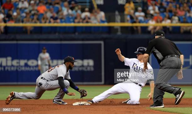 Joey Wendle of the Tampa Bay Rays slides into second on a double as Niko Goodrum of the Detroit Tigers applies the tag during a game at Tropicana...