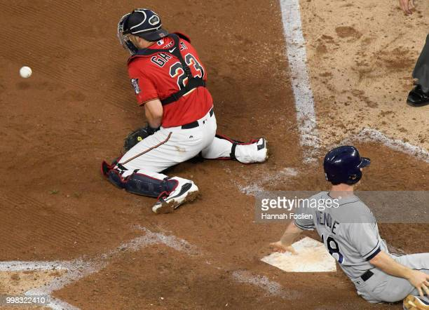 Joey Wendle of the Tampa Bay Rays slides safely slides as Mitch Garver of the Minnesota Twins fields the ball during the fifth inning of the game on...