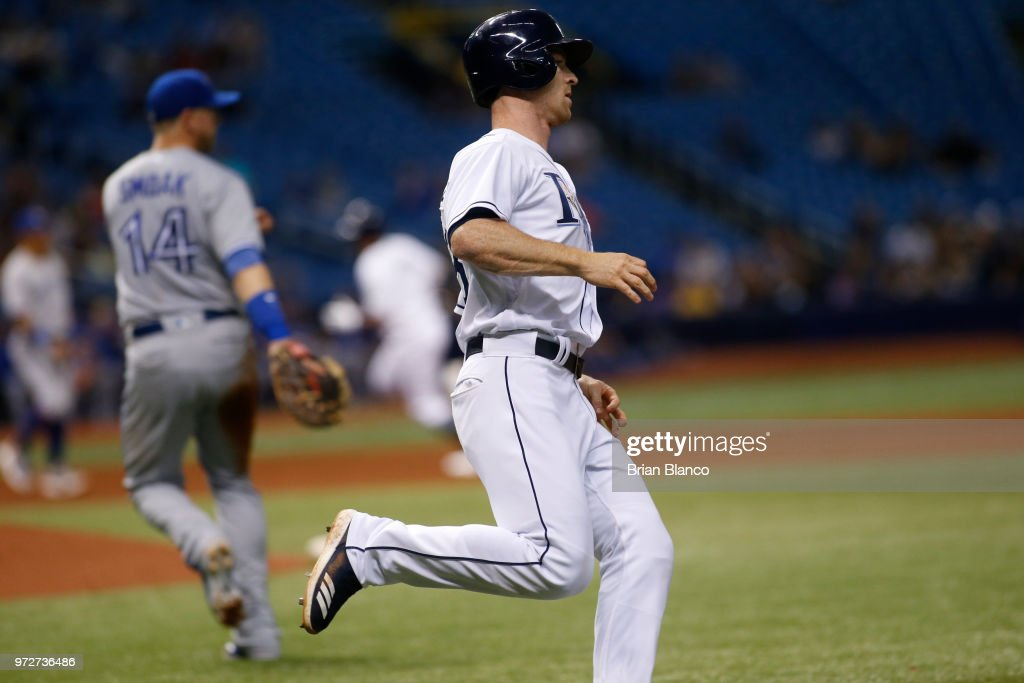 Joey Wendle #18 of the Tampa Bay Rays sprints toward first base after hitting an RBI single to score C.J. Cron during the sixth inning of a game against the Toronto Blue Jays on June 12, 2018 at Tropicana Field in St. Petersburg, Florida.