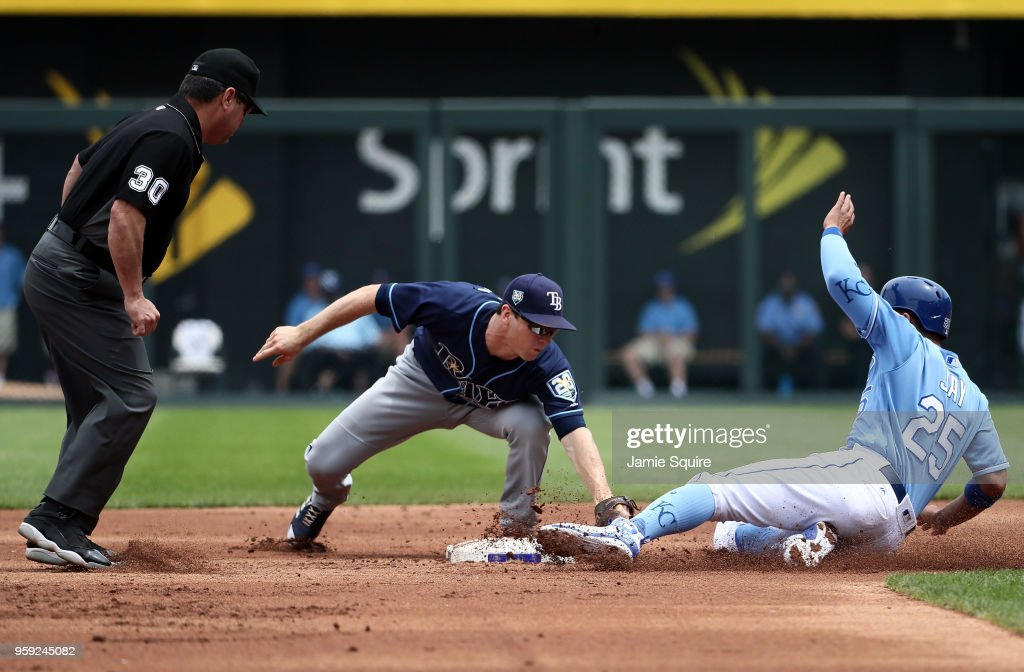 Joey Wendle #18 of the Tampa Bay Rays tags out Jon Jay #25 of the Kansas City Royals at second base during the 1st inning of the game at Kauffman Stadium on May 16, 2018 in Kansas City, Missouri.
