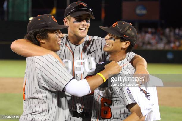 Joey Wong Jordan Lennerton and Darwin Barney of Oregon State University celebrate their victory over the University of North Carolina during the...