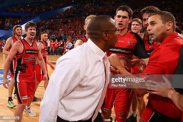 Joey Wright coach of the 36ers remonstrates with Wildcats assistant coach Adam Tatalovich after a post game melee during the round 18 NBL match...