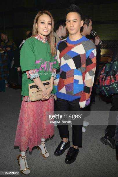 Joey Yung and Mason Lee wearing Burberry at the Burberry February 2018 show during London Fashion Week at Dimco Buildings on February 17 2018 in...