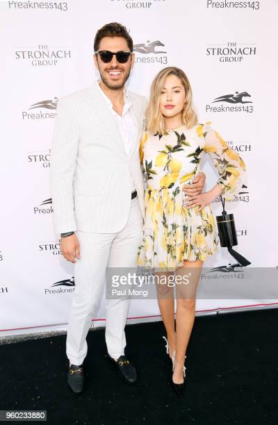 Joey Zauzig and Jourdan Sloane attend The Stronach Group Chalet at 143rd Preakness Stakes on May 19 2018 in Baltimore Maryland
