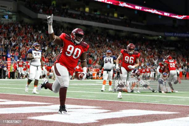 Joey Mbu of the San Antonio Commanders celebrates after a fumble return touchdown during the third quarter against the Orlando Apollos in an Alliance...