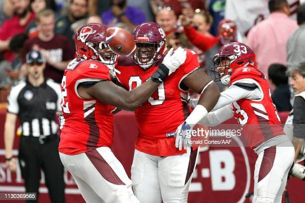 Joey Mbu of the San Antonio Commanders celebrates with teammates after a fumble return touchdown during the third quarter against the Orlando Apollos...