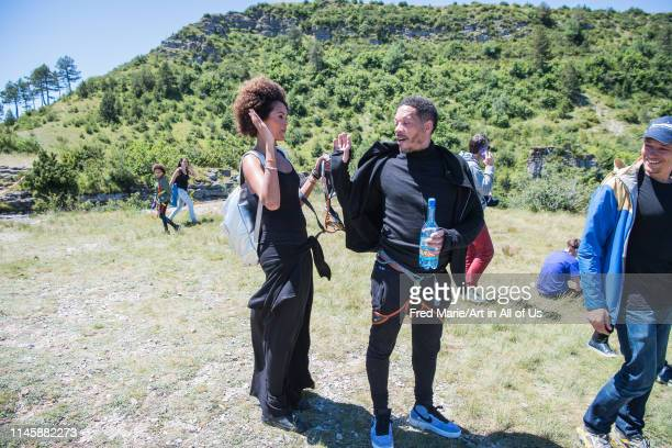 Joeystarr and sophie ducasse after his bungee jump from a cliff, Occitanie, Florac, France on July 3, 2017 in Florac, France.