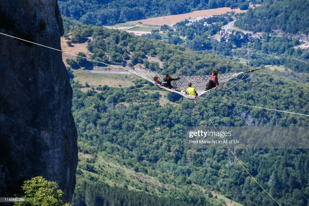 Joeystarr and sophie ducasse in a space net on the top of a cliff, Occitanie, Florac, France... : News Photo
