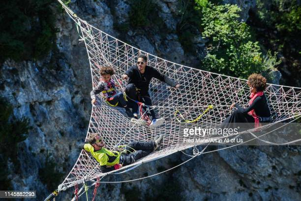 Joeystarr and sophie ducasse in a space net on the top of a cliff, Occitanie, Florac, France on July 3, 2017 in Florac, France.