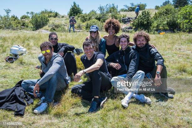 Joeystarr, Sophie ducasse, Tomer sisley, Maxime muska, Taïg khris and friends striking the pose during a bungee jump session from a cliff, Occitanie,...