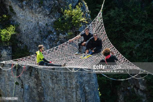 Joeystarr, Taïg khris and sophie ducasse in a space net on the top of a cliff, Occitanie, Florac, France on July 3, 2017 in Florac, France.