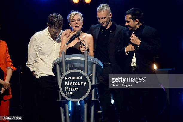 Standing beside Event host Irish radio and television presenter Annie Mac Joff Oddie Ellie Rowsell Theo Ellis and Joel Amey of Wolf Alice collect...