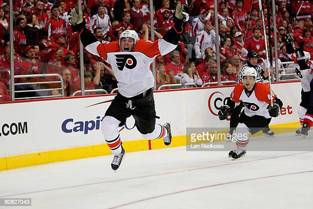 Joffery Lupul and Danny Briere of the Philadelphia Flyers celebrate Lupul's overtime winning goal against the Washington Capitals during game seven...