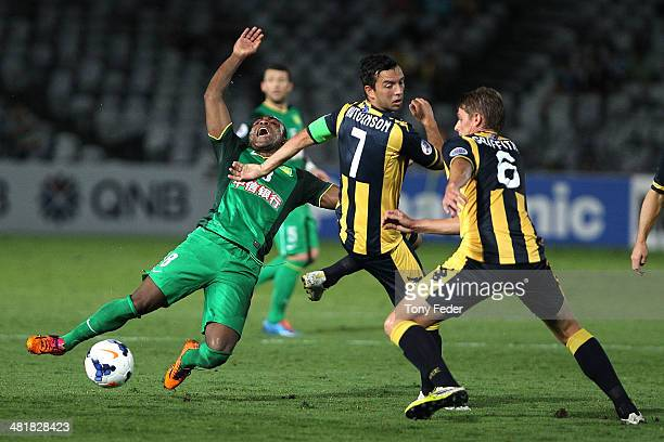 Joffre Guerron of Beijing Guoan is tackled by John Hutchinson of the Mariners during the Asian Champions League match between the Central Coast...