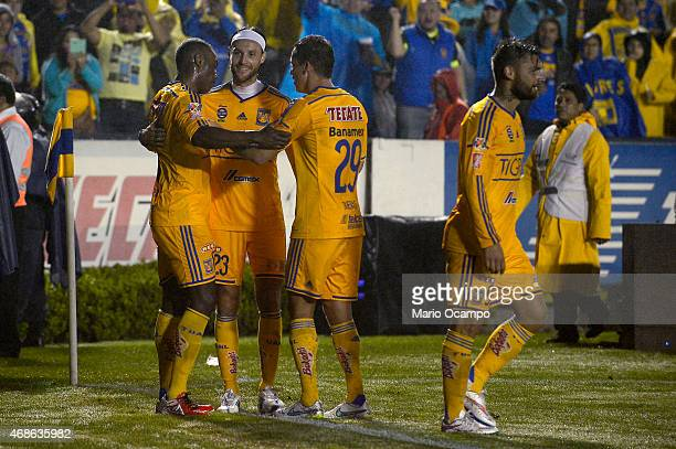 Joffre Guerron of Tigres celebrates with teammates after scoring his team's third goal during a match between Tigres UANL and Veracruz as part of...