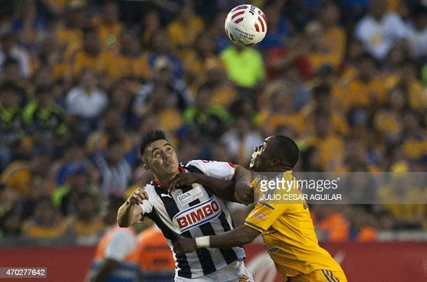 Joffre Guerron of Tigres vies for the ball with Efrain Velarde of Monterrey during their 2015 Mexican Clausura tournament football match in Monterrey...