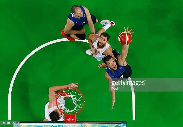 Joffrey Lauvergne of France goes for the rebound against Sergio Rodriguez of Spain during the Men's Quarterfinal match on Day 12 of the Rio 2016...