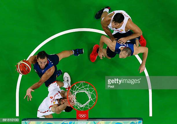 Joffrey Lauvergne of France goes to the basket against Felipe Reyes of Spain during the Men's Quarterfinal match on Day 12 of the Rio 2016 Olympic...