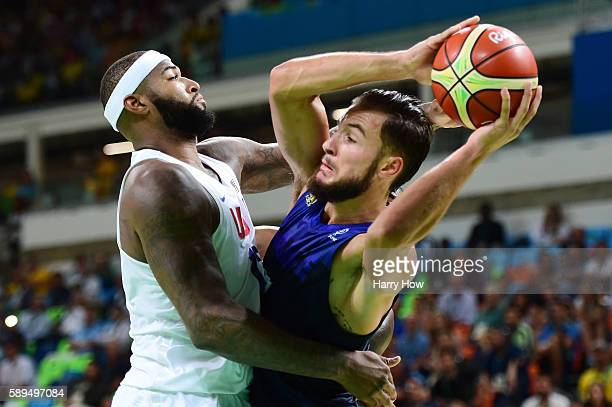 Joffrey Lauvergne of France works against Demarcus Cousins of United States during a Men's Preliminary Round Group A game between the United States...