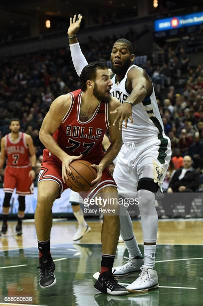 Joffrey Lauvergne of the Chicago Bulls is defended by Greg Monroe of the Milwaukee Bucks during the first half of a game at the BMO Harris Bradley...