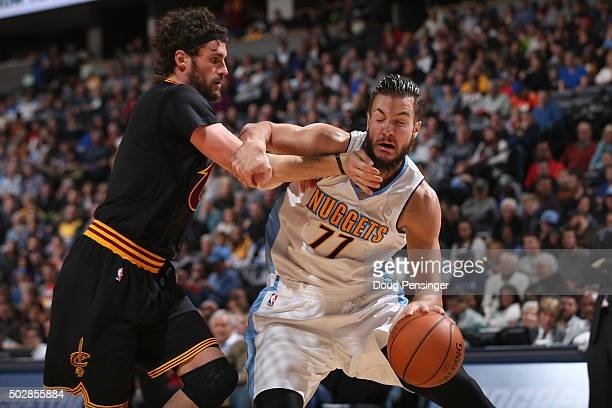 Joffrey Lauvergne of the Denver Nuggets controls the ball against the defense of Kevin Love of the Cleveland Cavaliers at Pepsi Center on December 29...
