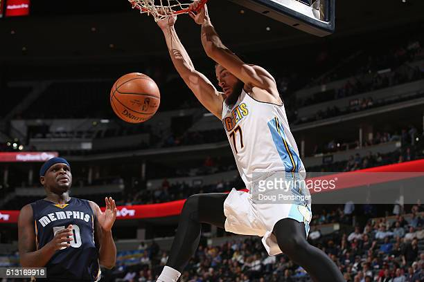 Joffrey Lauvergne of the Denver Nuggets dunks the ball against Zach Randolph of the Memphis Grizzlies at Pepsi Center on February 29 2016 in Denver...