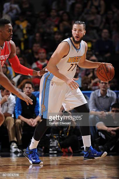 Joffrey Lauvergne of the Denver Nuggets handles the ball against the Houston Rockets on December 14 2015 at the Pepsi Center in Denver Colorado NOTE...
