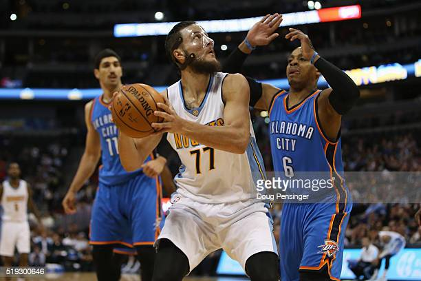 Joffrey Lauvergne of the Denver Nuggets looks to get off a shot against Randy Foye of the Oklahoma City Thunder at Pepsi Center on April 5 2016 in...