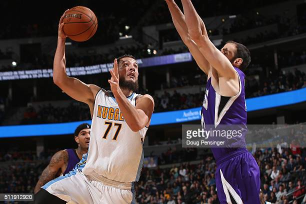 Joffrey Lauvergne of the Denver Nuggets puts up a shot against Kosta Koufos of the Sacramento Kings at Pepsi Center on February 23 2016 in Denver...