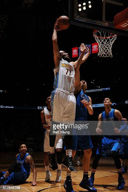 Joffrey Lauvergne of the Denver Nuggets shoots the ball against the Dallas Mavericks on March 28 2016 at the Pepsi Center in Denver Colorado NOTE TO...