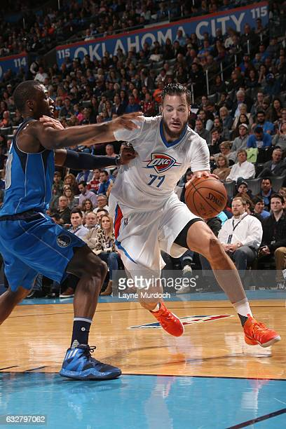 Joffrey Lauvergne of the Oklahoma City Thunder drives to the basket against the Dallas Mavericks on January 26 2017 at Chesapeake Energy Arena in...