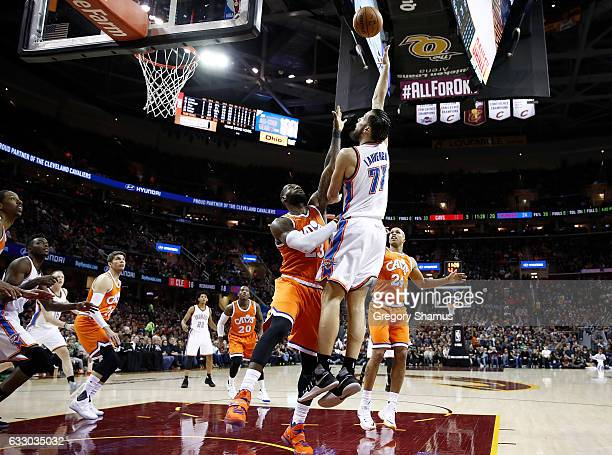 Joffrey Lauvergne of the Oklahoma City Thunder tries to get a first half shot off over LeBron James of the Cleveland Cavaliers at Quicken Loans Arena...
