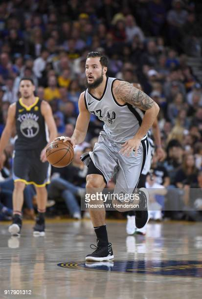 Joffrey Lauvergne of the San Antonio Spurs dribbles the ball up court against the Golden State Warriors during an NBA basketball game at ORACLE Arena...