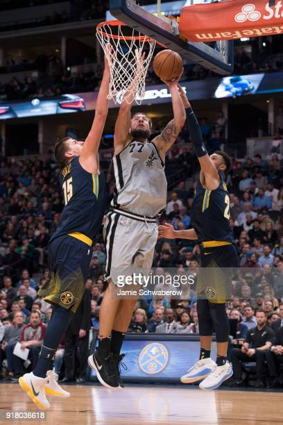 Joffrey Lauvergne of the San Antonio Spurs drives to the hoop against Nikola Jokic of the Denver Nuggets at Pepsi Center on February 13 2018 in...