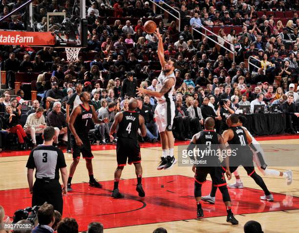 Joffrey Lauvergne of the San Antonio Spurs goes to the basket against the Houston Rockets on December 15 2017 at the Toyota Center in Houston Texas...