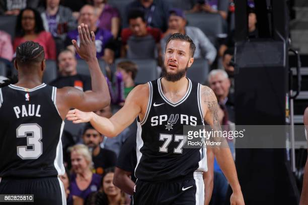 Joffrey Lauvergne of the San Antonio Spurs high fives teammate Brandon Paul during the game against the Sacramento Kings on October 2 2017 at Golden...