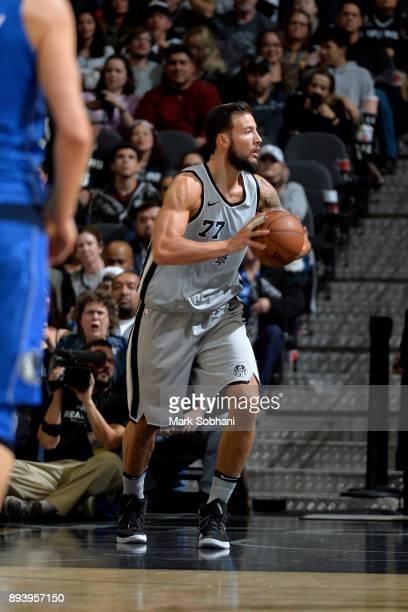 Joffrey Lauvergne of the San Antonio Spurs passes the ball against the Dallas Mavericks on December 16 2017 at the ATT Center in San Antonio Texas...