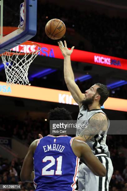 Joffrey Lauvergne of the San Antonio Spurs puts up a shot over Joel Embiid of the Philadelphia 76ers at Wells Fargo Center on January 3 2018 in...