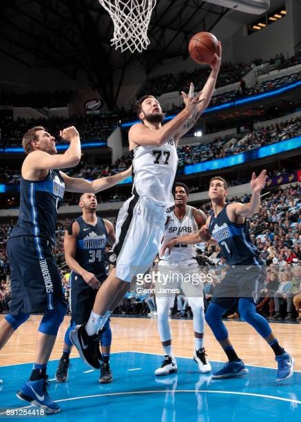 Joffrey Lauvergne of the San Antonio Spurs shoots a lay up against the Dallas Mavericks on December 12 2017 at the American Airlines Center in Dallas...